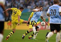 FUSSBALL   DFB POKAL 2. RUNDE   SAISON 2013/2014 TSV 1860 Muenchen - Borussia Dortmund         24.09.2013 Benjamin Lauth (Mitte, 1860 Muenchen) gegen Kevin Grosskreutz (li, Borussia Dortmund)
