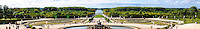 The Palace of Versailles, or simply Versailles, is a royal château close to Paris, France. Panorama view  of the Gardens of Versailles with the Bassin de Latone and Grand Canal in the background.