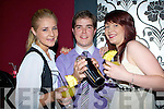 COCKTAILS: Gerard Murphy cocktail maker Benners Hotel making some cocktails for some pretty ladies who attended the first night at Benners Night Club, Tralee on Monday night, L-r: Liz Keeman, Gerard Murphy and Dani Rees...
