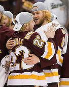 Mike Connolly (Duluth - 22), Trent Palm (Duluth - 5) - The University of Minnesota-Duluth Bulldogs celebrated their 2011 D1 National Championship win on Saturday, April 9, 2011, at the Xcel Energy Center in St. Paul, Minnesota.