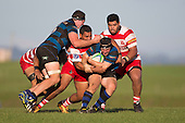 Andrew Jones has Kieran Whyte in support as he tries to wrestle his way free from the Karaka tacklers. Counties Manukau Premier Club Rugby game between Karaka and Onehwero played at Karaka Sports Park on Saturday May 7th 2016. Karaka won the game 46 - 9 after leading 20 - 9 at half time. Photo by Richard Spranger.