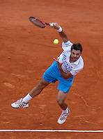Stanlinas Wawrinka (SUI) (20) against Roger Federer (SUI) (1) in the third round of the men's singles. Roger Federer beat Stanlinas Wawrinka 6-3 7-6 6-2..Tennis - French Open - Day 8 - Sun 30 May 2010 - Roland Garros - Paris - France..© FREY - AMN Images, 1st Floor, Barry House, 20-22 Worple Road, London. SW19 4DH - Tel: +44 (0) 208 947 0117 - contact@advantagemedianet.com - www.photoshelter.com/c/amnimages