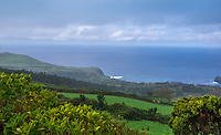 Fine Art Landscape Photograph of the coastline of Ponta Delgada. The well watered green countryside combined well with the rich deep ocean blues of the ocean and skyline.