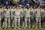 Soldiers take part in pre-game ceremonies on the field before the US Army All-American Bowl, Saturday, Jan. 9, 2010, at the Alamodome in San Antonio. (Darren Abate/pressphotointl.com)