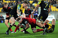 Ngani Laumape (right) and Jordie Barrett tackle Kieran Read during the Super Rugby match between the Hurricanes and Crusaders at Westpac Stadium in Wellington, New Zealand on Saturday, 15 July 2017. Photo: Dave Lintott / lintottphoto.co.nz