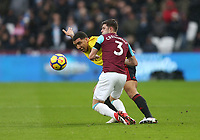 West Ham United's Aaron Cresswell and Watford's Troy Deeney<br /> <br /> Photographer Rob Newell/CameraSport<br /> <br /> The Premier League - West Ham United v Watford - Saturday 10th February 2018 - London Stadium - London<br /> <br /> World Copyright &copy; 2018 CameraSport. All rights reserved. 43 Linden Ave. Countesthorpe. Leicester. England. LE8 5PG - Tel: +44 (0) 116 277 4147 - admin@camerasport.com - www.camerasport.com