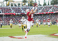 STANFORD, CA - November 30, 2013: Stanford Cardinal wide receiver Devon Cajuste (89) catches a pass for a touchdown during the Stanford Cardinal vs the Notre Dame Irish at Stanford Stadium in Stanford, CA. Final score Stanford Cardinal 27, Notre Dame Irish  20.