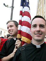 Due giovani sacerdoti statunitensi attendono davanti a piazza San Pietro, Vaticano, 13 giugno 2008, l'uscita del Presidente George W. Bush dopo l'incontro con il Papa..U.S. priests stand out of St. Peter's square, Vatican, 13 june 2008, waiting for the leaving of President George W. Bush after his meeting with the Pope..UPDATE IMAGES PRESS/Riccardo De Luca