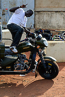 BURKINA FASO, Bobo Dioulasso, warehouse for chinese tricycle for rural transport / BURKINA FASO, Bobo Dioulasso, Firma vertreibt chinesisches Lastendreirad der Marken Apsonic, Apollo und Haojin