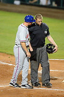 St. Lucie Mets manager Ryan Ellis #9 argues a call with umpire Clay Park during a game against the Bradenton Marauders on April 12, 2013 at McKechnie Field in Bradenton, Florida.  St. Lucie defeated Bradenton 6-5 in 12 innings.  (Mike Janes/Four Seam Images)