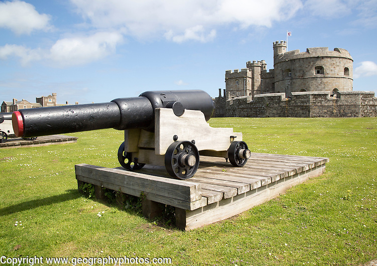 Cannon and historic buildings at Pendennis Castle, Falmouth, Cornwall, England, UK
