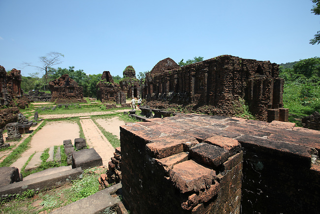 Partially-restored and damaged temples ring the main complex at My Son, Vietnam. The site was the primary religious center and royal burial grounds for the Champa kingdom, which flourished from 400 to 1500 A.D. and encompassed most of south and central Vietnam.  The temples were dedicated to the worship of the Hindu god Shiva. The most important structures were excavated and restored under French colonial rule, but many were heavily damaged or completely destroyed by American bombing during the Vietnam War. April 25, 2012.