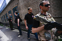 Pavel Gubarev - People's Governor of Donetsk People's Republic surrounded by bodyguards.