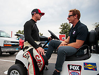 Sep 28, 2019; Madison, IL, USA; NHRA top fuel driver Steve Torrence (left) talks to Fox Sports announcer Brunbo Massel during qualifying for the Midwest Nationals at World Wide Technology Raceway. Mandatory Credit: Mark J. Rebilas-USA TODAY Sports