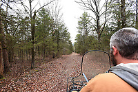 NWA Democrat-Gazette/FLIP PUTTHOFF <br /> Joe Pearson rides March 2019 along one of the log roads that meander through the camp.