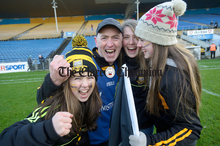 Ballyea manager Robbie Hogan celebrates with his daughters Emma, Lisa and Laura following the Munster Club hurling final against Glen Rovers at Thurles. Photograph by John Kelly.