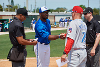 Dunedin Blue Jays manager Cesar Martin (16) shakes hands with Clearwater Threshers manager Marty Malloy (2) during the lineup exchange with umpires Hardie Acosta (left) and Tanner Dobson (right) before a Florida State League game on April 7, 2019 at Jack Russell Memorial Stadium in Clearwater, Florida.  Dunedin defeated Clearwater 2-1.  (Mike Janes/Four Seam Images)