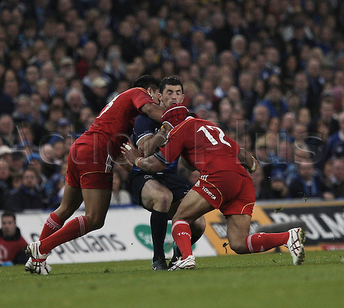 02.10.2010 Rugby Union Magners League Leinster v Munster. Rob Kearney (Leinster) is tackled high by Lifeimi Mafi (Munster) and also tackled by Sam Tuitupou (Munster).