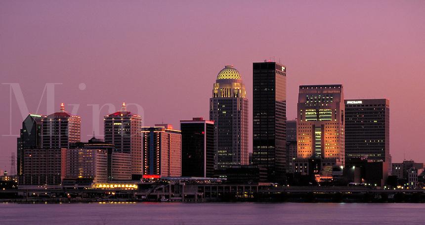 The Louisville, KY skyline at dusk over the Ohio River. Louisville Kentucky USA.