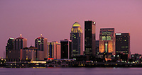 The Louisville, KY skyline at dusk over the Ohio River. Louisville Kentucky USA.