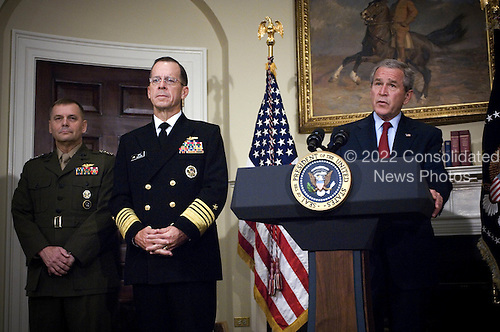 United States President George W. Bush (right) announces the nomination of Admiral Mike Mullen (2nd from left), U.S. Navy, and General James E. Cartwright as Chairman and Vice-Chairman of the Joint Chiefs of Staff, respectively, in the Roosevelt Room at the White House on June 28, 2007.  Mullen is currently the Chief of Naval Operations and Cartwright is the Commander of the U.S. Strategic Command. Cartwright is a target of a Justice Department investigation into a leak of information about a covert U.S.-Israeli cyberattack on Iran's nuclear program.<br /> Mandatory Credit: Chad J. McNeeley / DoD via CNP