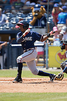Erison Mendez (9) of the Rome Braves follows through on his swing against the Asheville Tourists at McCormick Field on July 26, 2015 in Asheville, North Carolina.  The Tourists defeated the Braves 16-4.  (Brian Westerholt/Four Seam Images)
