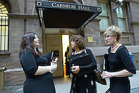 Jackie Gill (JACKIE GILL), left, Lynn Rae Lowe (LYNN RAE LOWE) and Jane Madsen (JANE MADSEN), members of the Southern Arizona Women's Chorus (formerly known as the Foothills Women's Chorus), chat outside the Carnegie Hall stage door before their performance in New York, NY on Sunday, June 25, 2006.