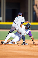 Nick Basto (19) of the Winston-Salem Dash slides under Jack Lopez (11) of the Wilmington Blue Rocks after being tagged out trying to steal second base at BB&T Ballpark on July 6, 2014 in Winston-Salem, North Carolina.  The Dash defeated the Blue Rocks 7-1.   (Brian Westerholt/Four Seam Images)