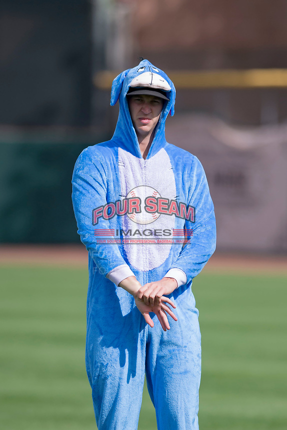 """Scottsdale Scorpions pitcher Cody Carroll (63), of the New York Yankees organization, stretches in his """"Eeyore"""" costume prior to an Arizona Fall League game against the Glendale Desert Dogs on October 31, 2017 at Scottsdale Stadium in Scottsdale, Arizona. The Scorpions defeated the Desert Dogs 6-2. (Zachary Lucy/Four Seam Images)"""