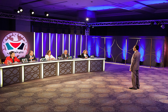 "June 2013, Ramallah, West Bank. In the T.V. program ""Al Rais"" (the president), the participant have to compete to be selected as the best fictional president. The question is based on ""what would you do if you were the president"". The aim of the program is presented as seeking to raise new interest from the youth in politics.  Mahmoud Abbas, the current president, was elected in controversial context in 2005, where Hamas had been given winner but the international community had pressure to keep the Fatah in power. Since then, the political situation has been frozen, and elections have not been yet called despite Abbas' mandate ended in January 2009, affecting the interest of Palestinians for internal politics and the trust in their representatives."