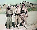 Iran 1979 .In the middle, with two peshmergas, Akram Agha, refugee in the camp of Ziweh.Iran 1979 .Au milieu avec deux peshmergas, Akram Agha, refugie dans le camp de Ziweh