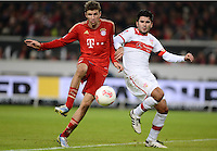 FUSSBALL   1. BUNDESLIGA  SAISON 2012/2013   19. Spieltag   VfB Stuttgart  - FC Bayern Muenchen      27.01.2013 Thomas Mueller (li, FC Bayern Muenchen) erzielt hier gegen Serdar Tasci (VfB Stuttgart)  das Tor zum 0-2
