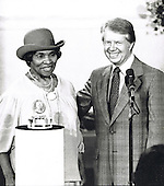 "Famed soprano Marian Anderson, left, and United States President Jimmy Carter, right, are shown at a ceremony in the East Room of the White House in Washington, DC where Ms. Anderson was awarded the Congressional Gold Medal, the highest civilian honor bestowed by the United States Congress, for her work in promoting the Arts around the world on Thursday, October 17, 1987.  The President praised Anderson as one who has brought great joy to the nation.<br /> Credit: Benjamin E. ""Gene"" Forte / CNP"