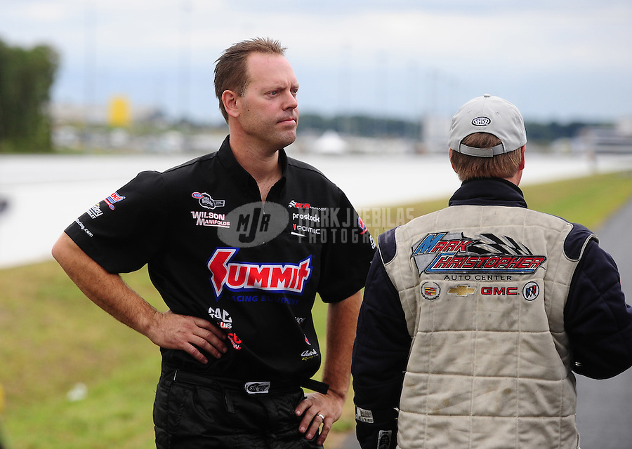 Sept. 18, 2011; Concord, NC, USA: NHRA pro stock driver Jason Line (left) after losing in the final round against Kurt Johnson the O'Reilly Auto Parts Nationals at zMax Dragway. Mandatory Credit: Mark J. Rebilas-