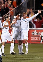 Houston Dynamo midfielder Brian Mullan (9), forward Brian Ching (25), and midfielder Brad Davis (11) celebrate a Kelly Gray (not shown) goal.  Houston Dynamo defeated Puntarenas FC 2-0 at the Aggie Soccer Complex in College Station, TX on March 1, 2007.  The Houston Dynamo advance to the semifinals of the CONCACAF Champions Cup on a 2-1 aggregate.