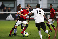 James Garner of Manchester United U23's takes on the Fulham U23's defence during Fulham Under-23 vs Manchester United Under-23, Premier League 2 Football at Motspur Park on 10th August 2018