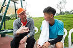Tennis Legend Boris Becker gives tips to a junior Chinese tennis player at Mission Hills Resort on 19 March 2016, in Shenzhen, China. Photo by Lucas Schifres / Power Sport Images