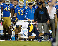Bryce Treggs of California catches the ball from California quarterback Jared Goff during the game against UCLA at Rose Bowl in Pasadena, California on October 12th, 2013.   UCLA defeated California, 37-10.