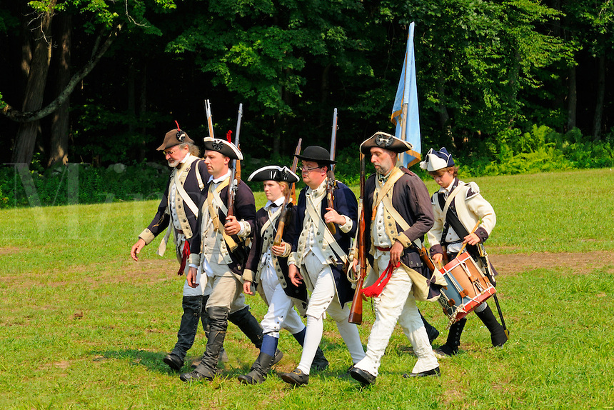 Continental Army soldiers of the 6th Connecticut Regiment, Company of Light Infantry, with drummer, march from the battlefield during a Revolutionary War reenactment at the Nathan Hale Homestead, Coventry, Connecticut, USA..