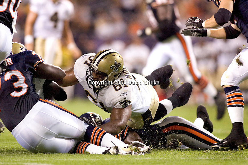 Offensive lineman Montrae Holland #61 of the New Orleans Saints battles for a loose ball against the Chicago Bears at Soldiers Field on August 27, 2004 in Chicago, Illinois. The Saints beat the Bears 17-13. (Photo by David Stluka)