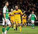 MICHAEL HIGDON CELEBRATES AFTER HE SCORES MOTHERWELL'S THIRD GOAL WITH A SPECTACULAR OVER HEAD KICK