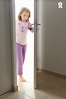 Girl (9) in pyjama opening her bedroom door (Licence this image exclusively with Getty: http://www.gettyimages.com/detail/100408138 )