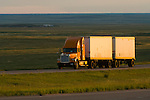 Trucking across the Great Plains on I-70 from the Colorado Rocky Mountains toward Kansas...**Trucking company logos removed in post production.