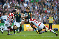Patrick Lambie of South Africa takes on the Japan defence. Rugby World Cup Pool B match between South Africa and Japan on September 19, 2015 at the Brighton Community Stadium in Brighton, England. Photo by: Patrick Khachfe / Onside Images