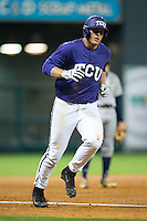 Luken Baker (19) of the Texas Christian Horned Frogs rounds the bases after hitting a home run against the Rice Owls during game six of the Shriners Hospitals for Children College Classic at Minute Maid Park on February 27, 2016 in Houston, Texas.  (Brian Westerholt/Four Seam Images)
