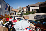 Professional movers load up Steve Reed's possessions in the Weston Ranch neighborhood of Stockton, Calif., March 6, 2012. Reed's family business went under in 2010, after 40 years in operation. Unemployed for two years, he's moving to Riverside for a new job.