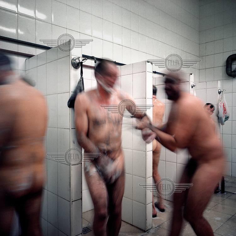 Miners taking a shower in the cloakroom at a local mine.