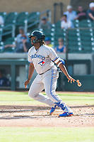 Surprise Saguaros third baseman Vladimir Guerrero Jr. (27), of the Toronto Blue Jays organization, releases his bat on his follow through during an Arizona Fall League game against the Salt River Rafters at Salt River Fields at Talking Stick on October 23, 2018 in Scottsdale, Arizona. Salt River defeated Surprise 7-5 . (Zachary Lucy/Four Seam Images)