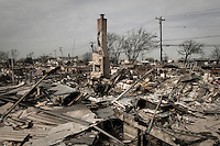 A fireplace stands from the debris of the burned during Hurricane Sandy 101 houses in Breezy Point, NY.