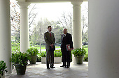 United States Trade Representative Robert Zoellick, left, has an informal discussion with Vice President Dick Cheney, right, on the Colonnade outside the Oval Office of the White House in Washington, DC prior to the photo op with King Abdullah II of Jordan on April 10, 2001.<br /> Credit: Ron Sachs / CNP